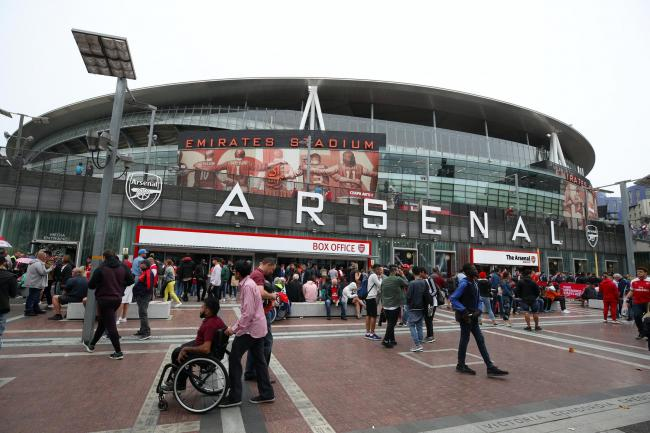 Fans arrive at the Emirates Stadium