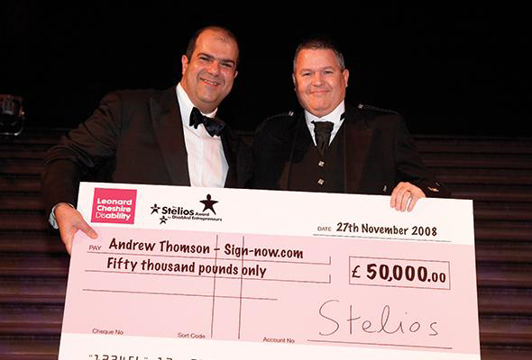 "(TODAY) Collect Pic: The Central Scotland News Agency File Name: ThomsonSteliosAward.jpg  DEAF BUSINESSMAN ANDREW THOMSON, WHO WON BRITAIN'S TOP AWARD FOR DISABLED ENTREPRENEURS, IS PICTURED ON THE ""DISABLED ENTREPRENEURS UK"" WEBSITE, RECEIVING"