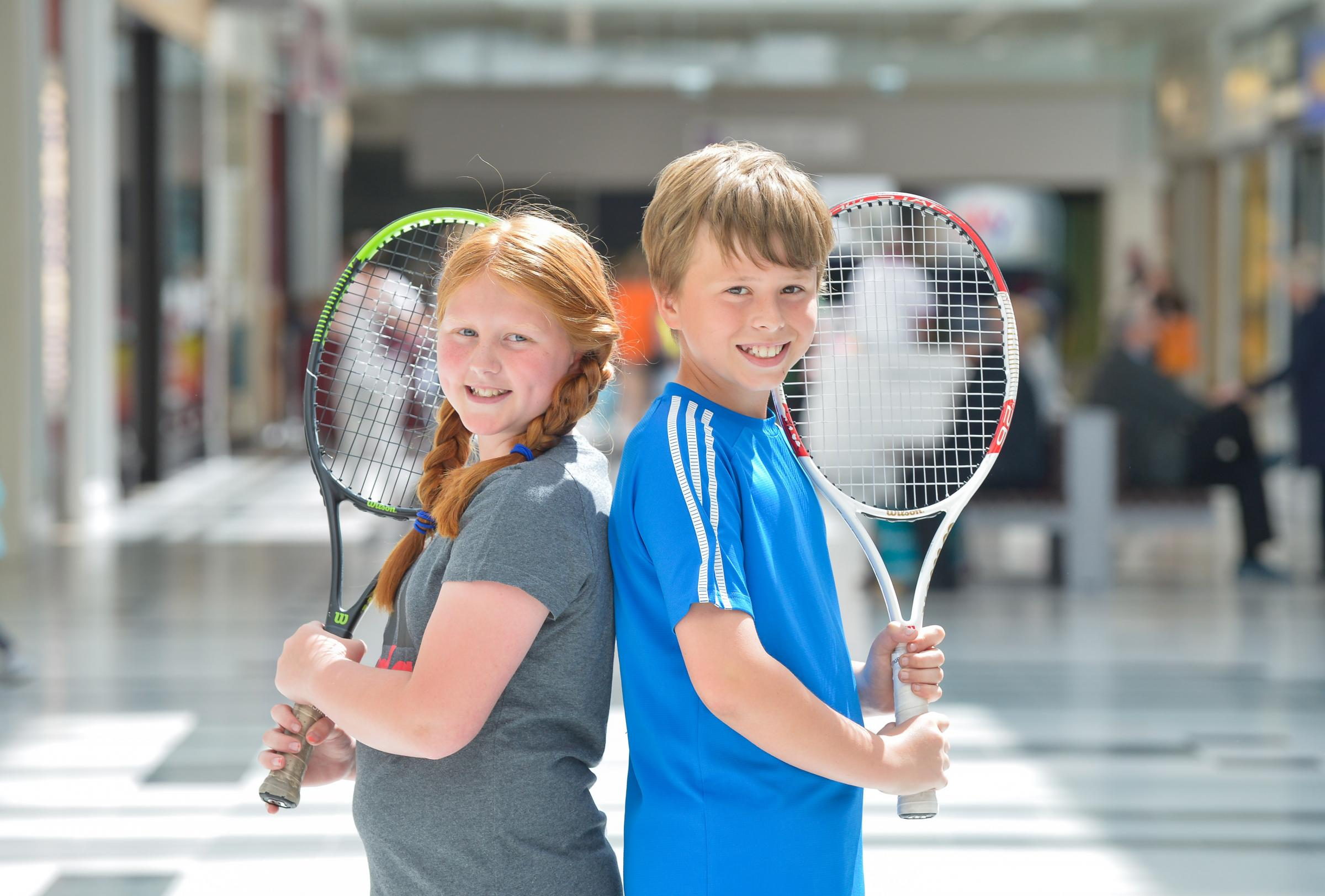 SOME RACKET: Grace McIlwaine, 10, and Ben Learmonth, 11, at the Thistles.